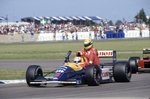 1991 British Grand Prix. Silverstone, Great Britain. 14 July 1991. Nigel Mansell, Williams FW14-Renault, 1st position, gives Ayrton Senna, McLaren MP4/6-Honda, 4th position, a lift back to the pits, action. Wall Art & Canvas Prints by Anonymous