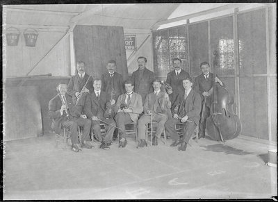 First World War Internee Orchestra inside internment hut, Douglas or Knockaloe Wall Art & Canvas Prints by Anonymous