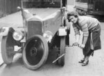 Ivy Cummings changing a tyre on a 1925 Singer 10/26 Wall Art & Canvas Prints by Peter Miller