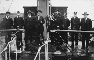 Group portrait including Captain H.J. Bray (with dog Ollie) and apprentices on deck, at Tacoma, USA by unknown - print