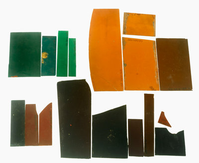 Eighteen pieces of coloured glass (five amber, three crimson, four dark green, six purple) in a bag by unknown - print