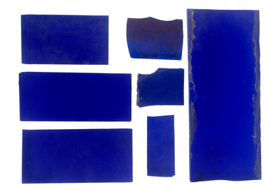 Seven pieces of cobalt blue pieces of glass in a bag by unknown - print