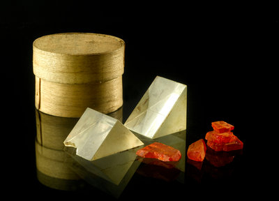 Pill box containing two prisms and red coloured crystals by unknown - print