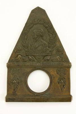 Brass watch stand in the form of a monument commemorating Vice-Admiral Horatio Nelson (1758-1805) and his victories at the Nile, Copenhagen and Trafalgar by unknown - print