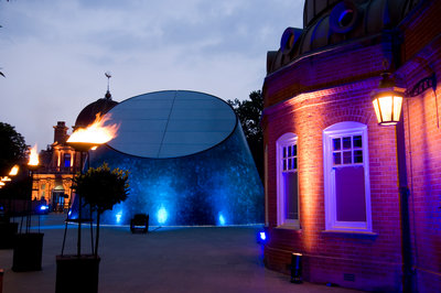 Night-time view of illuminated Royal Observatory, Greenwich, including the Peter Harrison Planetarium, Astronomy Centre (South Building) and Altazimuth Building by National Maritime Museum Photo Studio - print