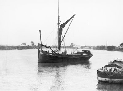 The 'Olive May' (1920), a port bow view of the barge stopped with sails furled by Anonymous - print