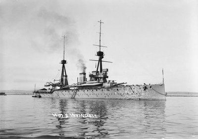 Battlecruiser HMS 'Invincible' (1907) in 1911-1912, at anchor with awnings rigged amidships and aft by unknown - print