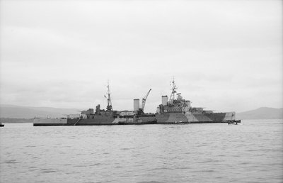 HMS 'Bermuda' (1941) at anchor in the Clyde, preparing for refit by unknown - print