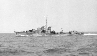 HMS 'Janus' (Br, 1938), under way at speed off Alexandria, passing HMS 'Phoebe' (Br, 1939), 12 May 1941 by unknown - print