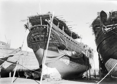Stern quarter view of a fine baggala drawn up on the Kuwait waterfront by Alan Villiers - print