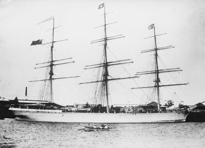 Photograph of 'Astracana' (1874) at quayside, Port Adelaide. Additional painted flags added by unknown - print
