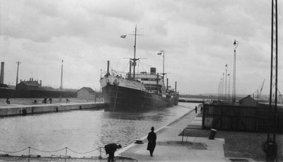 'Radnorshire' (Br, 1919) cargo liner, Royal Mail Steam Packet Co., in King George V Dock lock, London by unknown - print