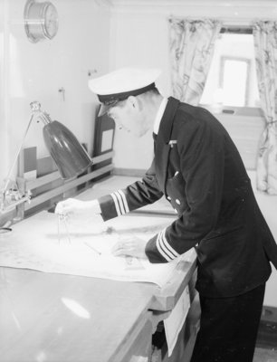 A ship's officer at the chart table of passenger liner 'Kenya' (1951) by unknown - print