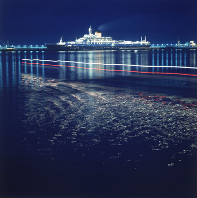A night shot of an unspecified cruise liner under way by Marine Photo Service - print