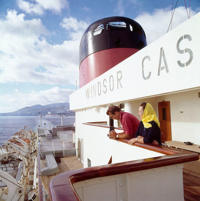 Two passengers enjoy the view from the upper deck of Union-Castle liner 'Windsor Castle' by Marine Photo Service - print