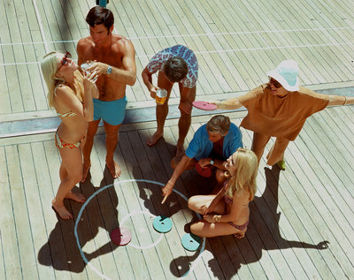 A group of passengers aboard an unspecified cruise ship enjoy a game of deck quoits by Union Castle Line Collection - print