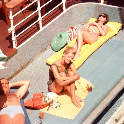 Passengers sunbathe aboard an unspecified cruise liner by Marine Photo Service - print