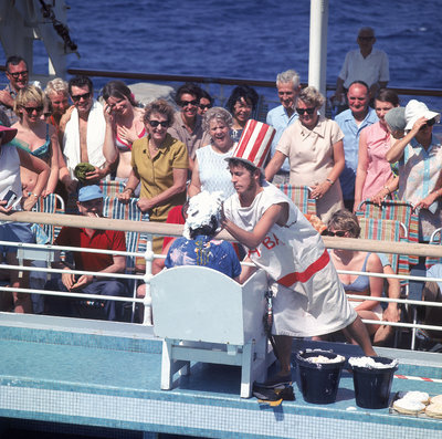 Comic hijinx aboard an unspecified cruise ship keeps the passengers entertained during the voyage - perhaps a variant of the Crossing the Line (the Equator) ceremony? by Marine Photo Service - print