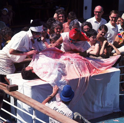 Macabre comic entertainment aboard an unspecified cruise ship - perhaps a variant of the Crossing the Line (the Equator) ceremony? by Marine Photo Service - print