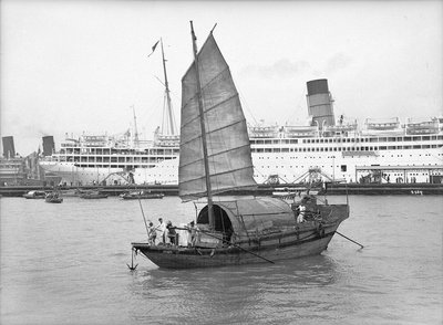 A junk in Hong Kong harbour, 1933 by Marine Photo Service - print