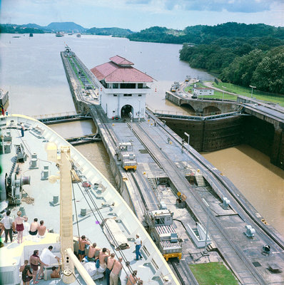 A view from the bridge of 'Gripsholm' (1957) or 'Kungsholm' (1966) of the Pedro Miguel Lock, Panama Canal, with the Miraflores Lock in the background. by Marine Photo Service - print