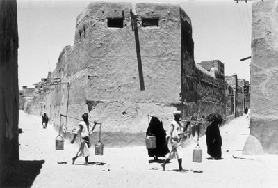Women and water carriers on the street, Kuwait by Alan Villiers - print
