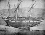 Broadside view of two unidentified vessels at low tide by unknown - print