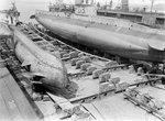 HM submarine D3 (1910) in floating dock at Harwich. by Charles Dixon - print