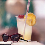 Cocktail and sunglasses aboard a Union-Castle cruise liner