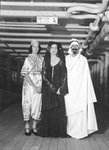 Passengers dress up in Middle Eastern costume for an obscure tableau aboard an unspecified cruise ship by unknown - print
