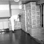 A storeroom containing boxes of Tetley's tea bags and Kellogg's Frosties, onboard 'Iberia' (1954)