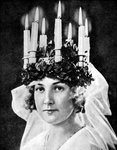 Scandinavian girl wearing candle headdress on St Lucy's Day Wall Art & Canvas Prints by Patricia O'Brien