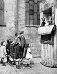Children watching a Punch and Judy show in a London street Fine Art Print by William Hogarth