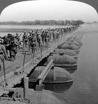 Machine gun section and infantry crossing a pontoon bridge, World War I Fine Art Print by Henry Alexander Ogden