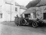 A family standing beside their car, Gorphwysfa Hotel, North Wales Fine Art Print by Peter Miller