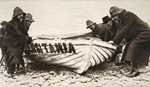 Hauling one of the 'Lusitania's' lifeboats onto the beach Wall Art & Canvas Prints by William Francis Phillipps