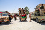 Free Libyan Army troops pose with the Flag of the National Transitional Council. Wall Art & Canvas Prints by .