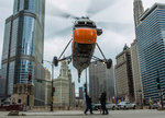 An S-58T helicopter comes down to street level in Chicago, Illinois. Postcards, Greetings Cards, Art Prints, Canvas, Framed Pictures & Wall Art by Max Ferguson