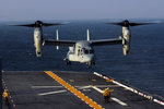 A V-22 Osprey aircraft prepares to land aboard the USS Bataan in the Atlantic Ocean. Wall Art & Canvas Prints by Wilf Hardy