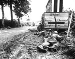 Infantrymen seek cover during a firefight in Libin, Belgium, during WWII. Wall Art & Canvas Prints by Pawel Kowalewsky