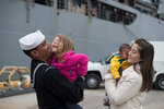 U.S. Navy sailor greets his family during homecoming. Postcards, Greetings Cards, Art Prints, Canvas, Framed Pictures, T-shirts & Wall Art by Alexander Chisholm