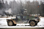 U.S. Army paratrooper fires an M2 .50-caliber machine gun atop a humvee. Wall Art & Canvas Prints by Anonymous