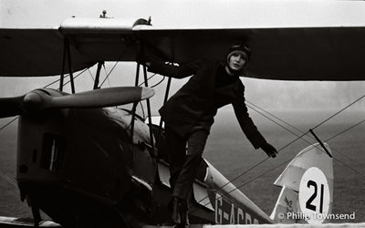 Karina Sterry with her Tiger Moth (small) by Philip Townsend - art